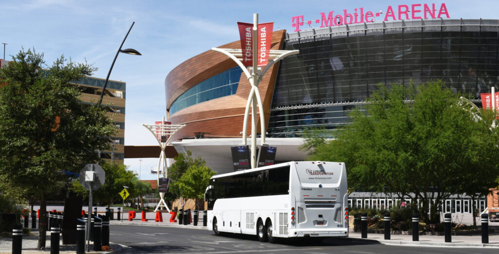 TLC Luxury charter bus driving past T-Mobile Arena in Las Vegas, NV