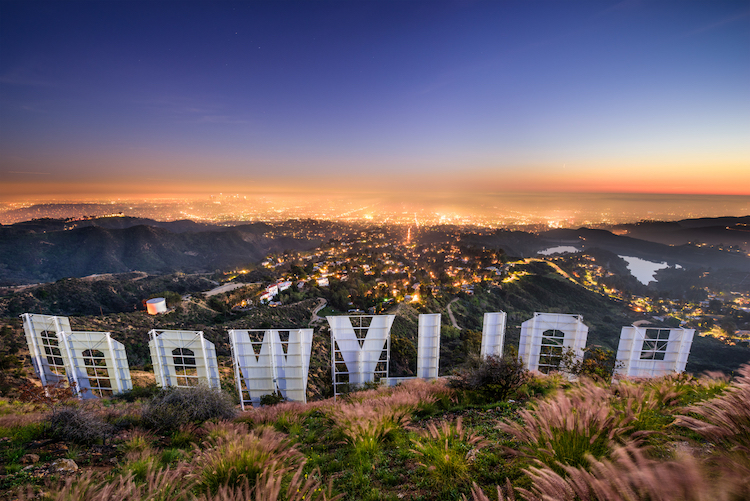 Hollywood Sign seen from the back during a Hollywood Hills hike looking out at downtown Los Angeles at sunset